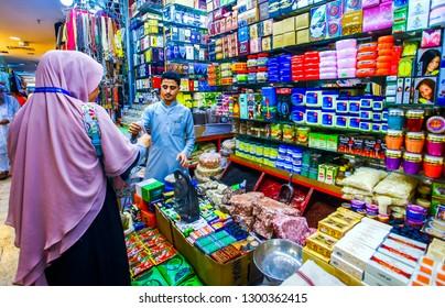 Mecca, Saudi Arabia : a pilgirim shopping in Ja'fariyah Market before going home after doing hajj and umra (09/2018).