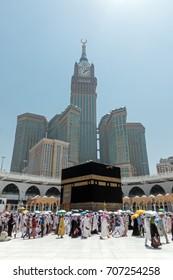 Mecca, Saudi Arabia - September 10, 2016: Muslim pilgrims put on their white ihrams circling around the holy Kaaba at daytime during Hajj in Saudi Arabia