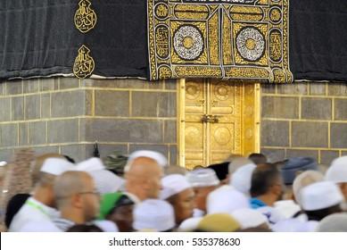 Mecca, Saudi Arabia - September 14, 2016: Muslim pilgrims in motion in front of the door of the holy Kaaba during Hajj in Saudi Arabia