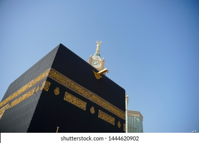 Mecca, Saudi Arabia. Taken on May, 2019.  Close up shot for the kaabah against blue sky with Safa Tower.