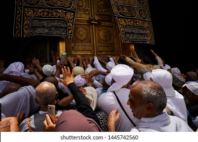 Mecca, Saudi Arabia. Taken on May, 2019. Pilgrims from multi age in crowded to touching the wall of kaabah for the ritual umrah or hajj. close up shoot.