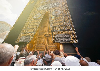 Mecca, Saudi Arabia. Taken on May, 2019. wide angle close up shoot in kaabah door. pilgrims hanging on wall.