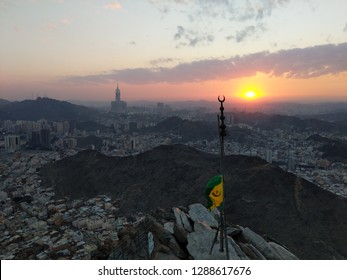 "MECCA, SAUDI ARABIA-DECEMBER 11, 2018: A view of Mecca City,Masjidlharam during the dawn fajr from the Mount of light ""Jabal An-Nour"" where located the Hira cave"