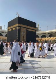 MECCA, SAUDI ARABIA-JANUARY 2018 : Unidentified Muslim pilgrims circumambulate the Kaabah in Mecca, Saudi Arabia.