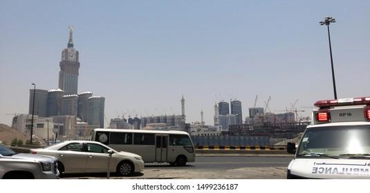MECCA, SAUDI ARABIA-JULY 25, 2019 : Royal Makkah Clock Tower (abraj al bait or Zamzam tower, left) stands tall, viewed from a local hospital centre in Mecca, Saudi Arabia.