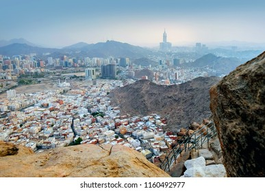 "MECCA, SAUDI ARABIA-JULY 29, 2017: A view of Mecca City,Masjidlharam during the dawn fajr from the Mount of light ""Jabal An-Nour"" where located the Hira cave"