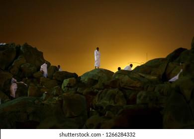 Mecca, Suudi Arabia  / Suudi Arabia - 15.11.2010: Muslims climbs and pray at Arafat mountain  to be haji.