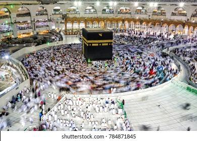 MECCA-DEC 15, 2017 : Muslim pilgrims circumambulate the Kaaba at Masjidil Haram in Makkah, Saudi Arabia. Muslims all around the world face the Kaaba during prayer time.