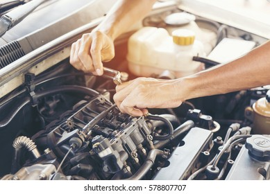 Mechanic Car Service in automobile garage auto car and vehicles service mechanical engineering. Automobile mechanic hands car repairs automotive workshop service center. Services car engine machine.
