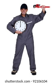 Mechanic with a clock and wrench