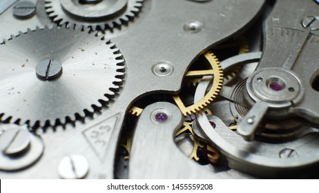 Mechanic clockwork mechanism works with bronze spring and metal cogs. Concept of successful business or teamwork
