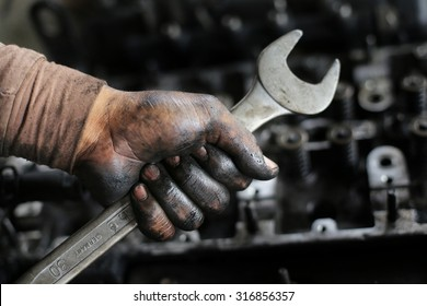 Mechanic with dirty hand from lubricant.