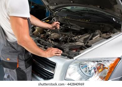 Mechanic engine repair close up