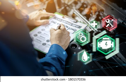 Mechanic engineer futuristic hologram icon repairing diagnosing checking motor vehicle car parts fixing issues problem broken engine, using clipboard pen man in professional uniform working in garage