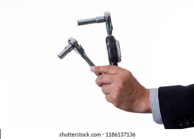 Mechanic engineer holding digital torque wrench and ratchet with socket in his hand; handing tool on white background with clipping path