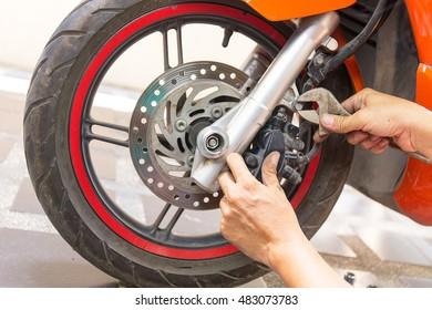 mechanic fixing motocycle  worn motorcycle drum breaks shoes