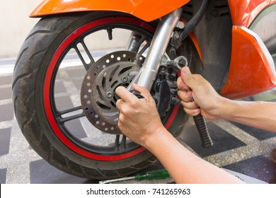 mechanic fixing motocycle  worn motorcycle drum breaks shoes