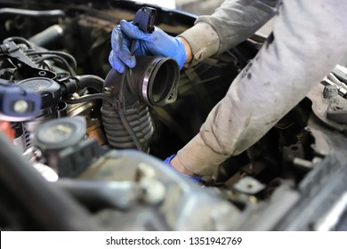 Mechanic fixing the turbo to add mor horse power