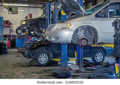 Mechanic garage with vehicles being worked on