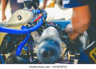 The mechanic hand go kart racing engine's service check the availability in the competition.