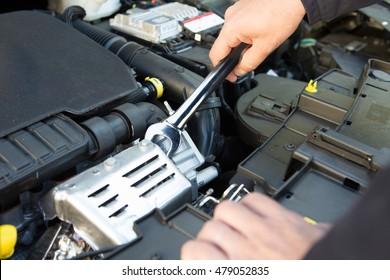 Mechanic Holding Spanner Fixing Car Engine