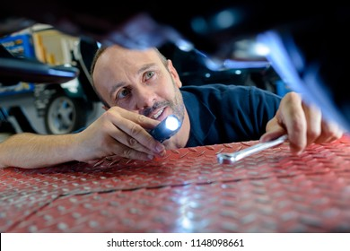mechanic holding a torch