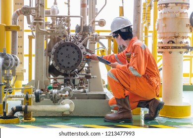 Mechanic inspector engineer check condition of crude oil centrifugal pump and lube oil system at offshore gas central processing platform, power and energy service business industry.