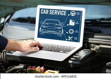 Mechanic with laptop near car engine. Modern car diagnostic program on screen. Car service concept.
