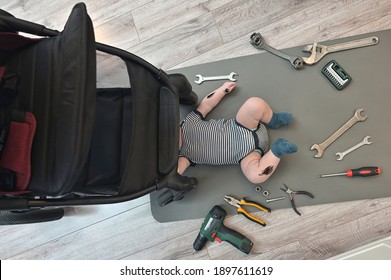 Mechanic Little Boy Repairing Suspension of A Baby Stroller - Shutterstock ID 1897611619