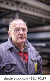 mechanic looking weary in garage