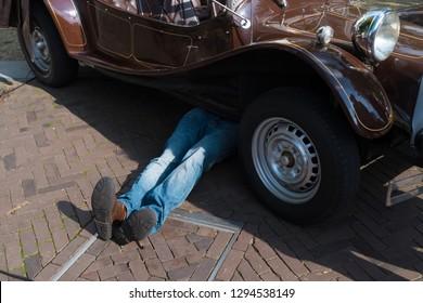 mechanic lying under a car