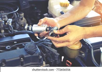 Mechanic man fix a super car engine , car service , car maintenance concept, repairing car