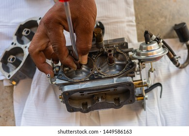 Mechanic man repair the carburetor for fire pumps
