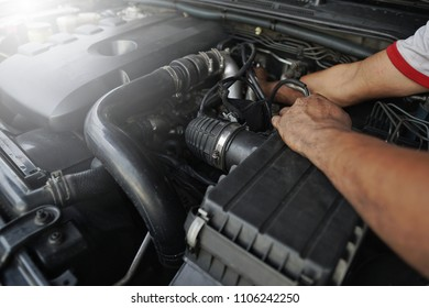 Mechanic man working and repair car engine in car service centre.Automobile metal car engine part details.Concept of modern vehicle motor,Industry,Mechanic and Business.