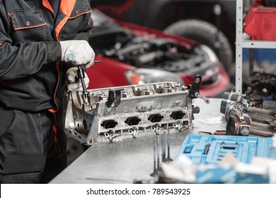 the mechanic opened the locking valve mechanism. Disassemble engine block vehicle. Motor capital repair. Sixteen valves and four cylinder. Car service concept.