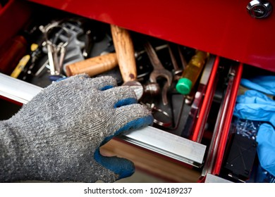 a mechanic opening a draw of tools