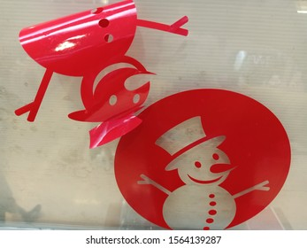 The mechanic is putting sticker Snowman on the glass. , Marry Christmas, Happy New Year 2020