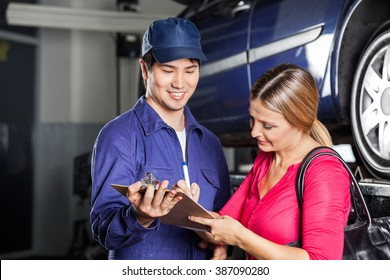 Mechanic Receiving Sign On Invoice From Customer