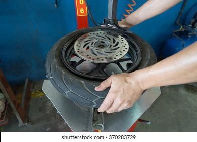 Mechanic removes tire closeup