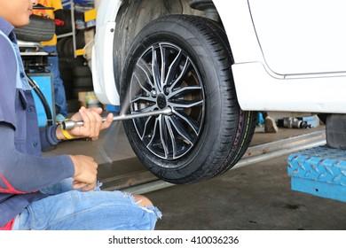 mechanic repaired wheeled vehicles in the garage.
