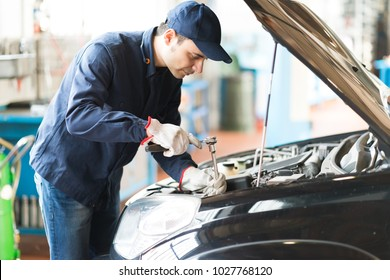 Mechanic repairing a car in his garage