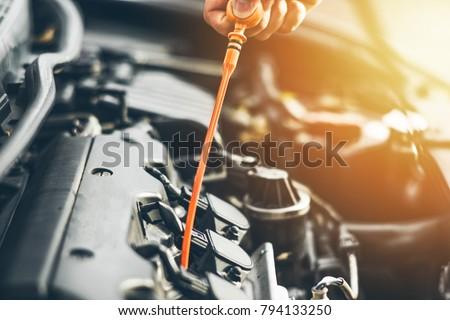 Mechanic Repairing Car Open Hood Side View Stock Photo Edit Now