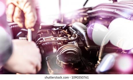 Mechanic is repairing the cars engine
