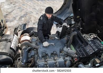 Mechanic repairing the truck