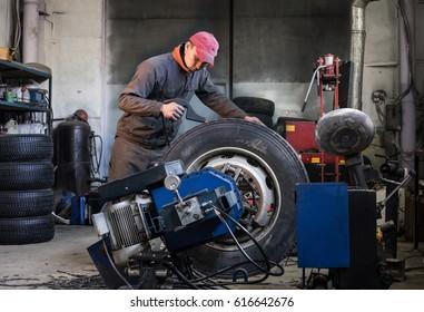 mechanic is repairing truck wheels