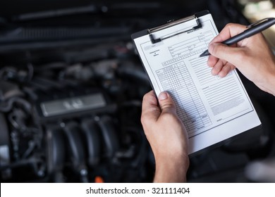 mechanic repairman inspecting car closeup