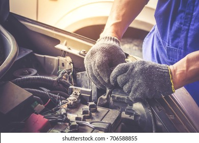 Mechanic repairs car in a car repair station