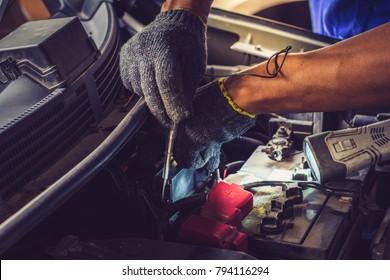 Mechanic repairs car in a car repair station