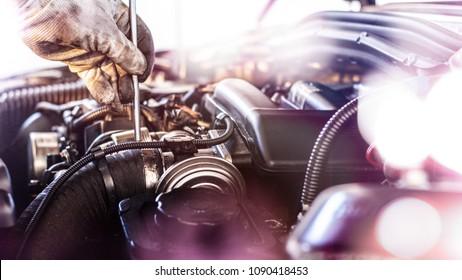 Mechanic repairs the engine