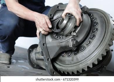 Mechanic repairs the truck